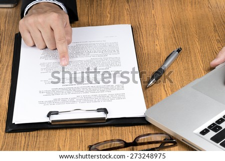 businessman hand checking marketing document.document is mockup - stock photo
