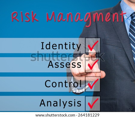 Businessman hand checking the checklist boxes risk management identity assess control analysis by pen on transparent glass. Isolated on blue background. Stock Iamge - stock photo