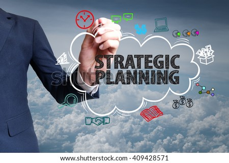 businessman hand draw cloud , icon cartoon with STRATEGIC PLANNING   text , business online , business concept ,business idea , analysis concept - stock photo