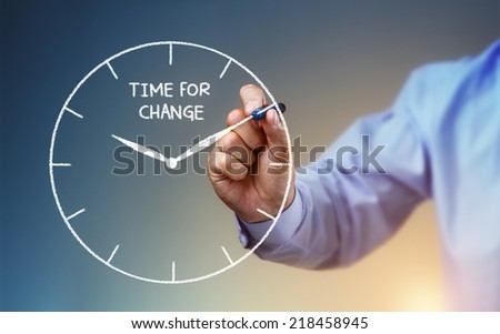 Businessman hand drawing a clock on whiteboard with time for change concept for planning, improvement and progress - stock photo