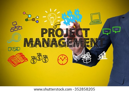 businessman hand drawing and writing PROJECT MANAGEMENT on yellow background , business concept , business idea - stock photo