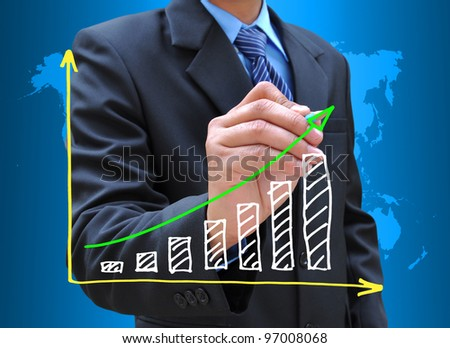 businessman hand drawing business graph - stock photo