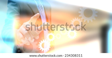 businessman hand drawing business graph and cog gear  - stock photo