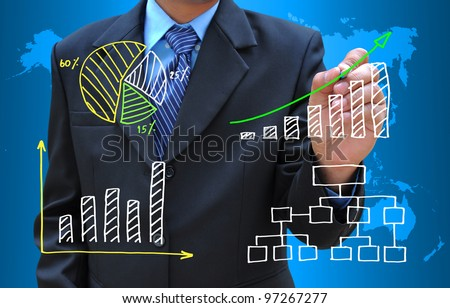 businessman hand drawing business graph and diagram - stock photo