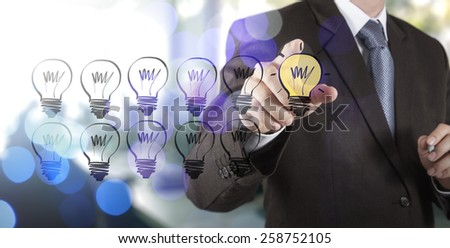 businessman hand drawing creative business strategy with light bulb as concept
