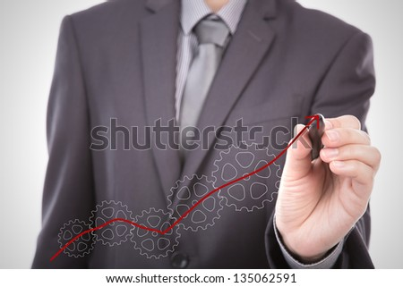 Businessman hand drawing gear to success concept - stock photo