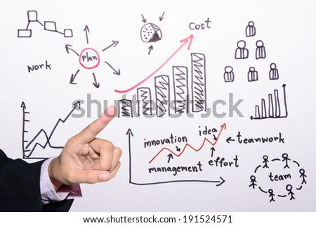 Businessman hand drawing graph  - stock photo