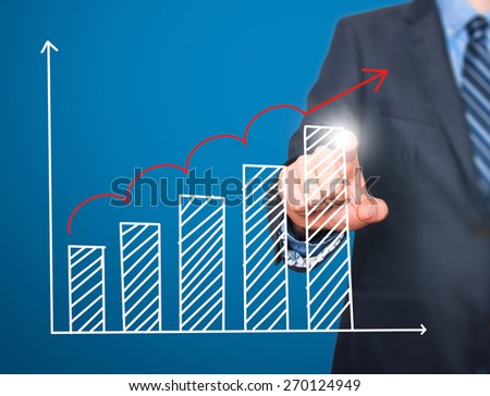Businessman hand drawing growth graph on visual screen. Isolated on blue. Man finger on chart. Business, internet, technology concept. Stock Image - stock photo