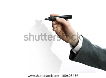 Businessman hand drawing in a whiteboard - stock photo