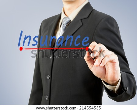 businessman hand drawing line insurance - stock photo