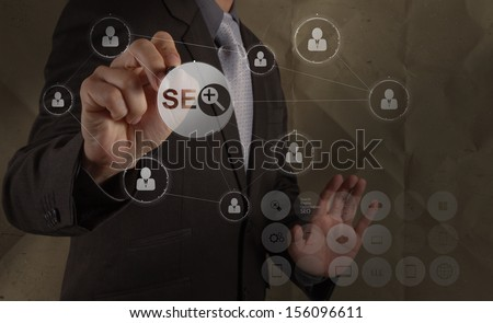 businessman hand drawing search engine optimization SEO with recycle crumpled paper background as concept - stock photo