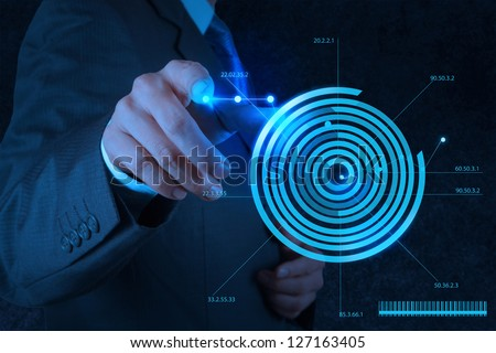 businessman hand drawing virtual chart business on modern computer