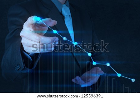 businessman hand drawing virtual chart business on touch screen computer - stock photo
