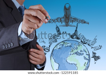 businessman hand draws airplane travel around the world - stock photo