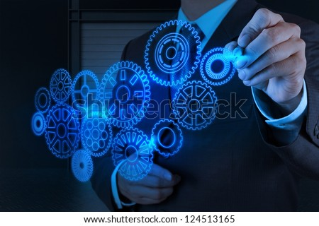 businessman hand draws new technology gear to success concept - stock photo