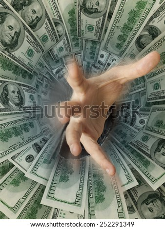 Businessman hand drowning in money hole (Shallow DOF) credit concept - stock photo