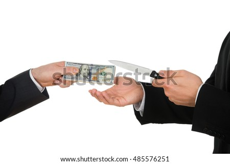 Businessman Hand Giving Money To The Businessperson With Sharp Knife Over White Background