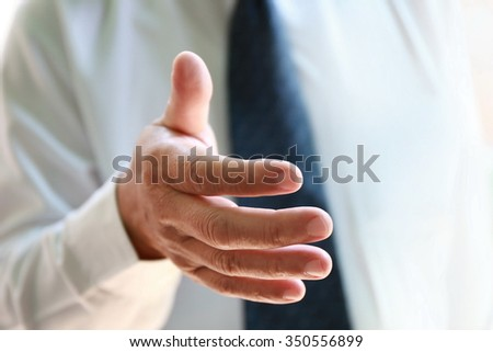 businessman hand hold together,Business handshake and business people. Business handshake for closing the deal after singing the lucrative contract between companies.Trust business partner