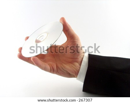 businessman hand holding a CD - stock photo