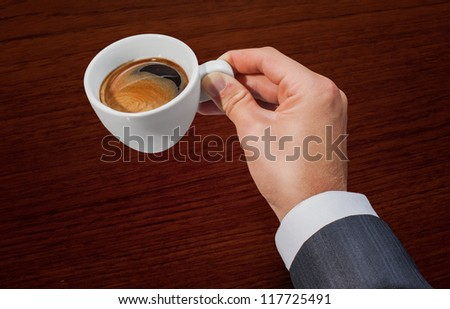 Businessman hand holding a cup of coffee