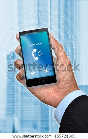 Businessman hand holding a generic smart phone with an incoming call.  You can change the phone screen easily  to suit your need.