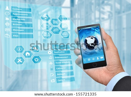 Businessman hand holding a generic smart phone with the virtual phone menu revealed. - stock photo