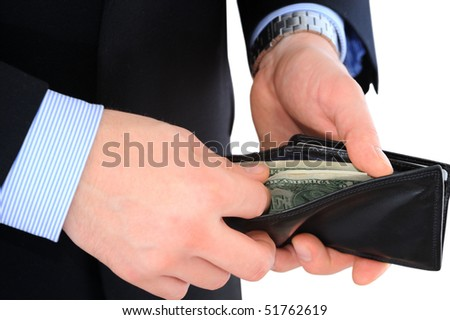 Businessman hand holding a opened leather wallet and taking money out isolated over white - stock photo