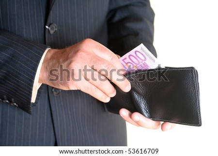 Businessman hand holding a opened leather wallet and taking money out isolated over white