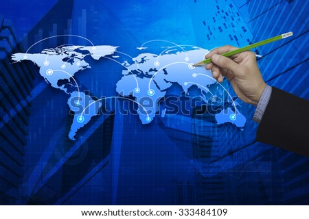 Businessman hand holding a pencil pointing at global business connection map, Elements of this image furnished by NASA