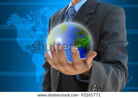 businessman hand holding a world - stock photo