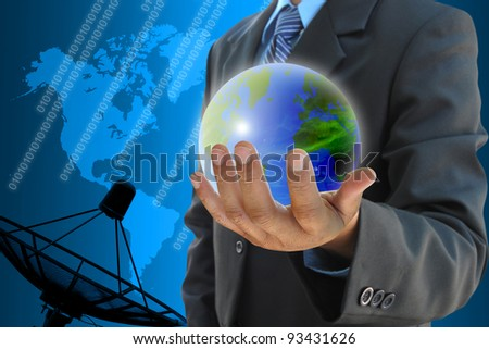 businessman hand holding a world and satellite dish antennas background - stock photo