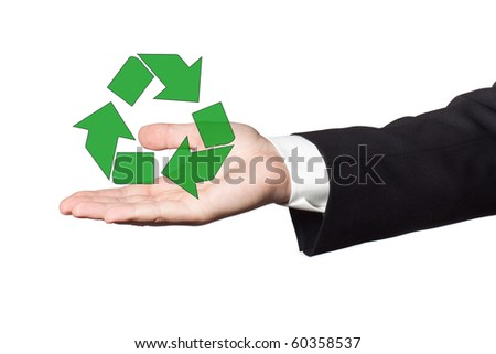 Businessman hand holding and showing recycling symbol - stock photo