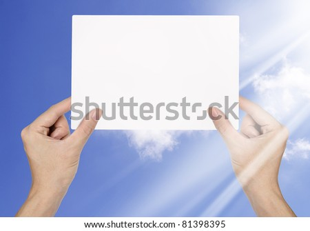 Businessman hand holding blank paper on blue sky background - stock photo