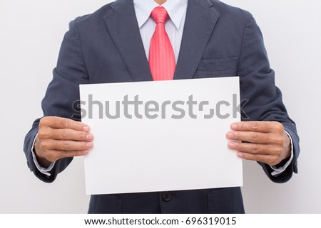 Businessman hand holding blank white paper board wearing suit and red necktie