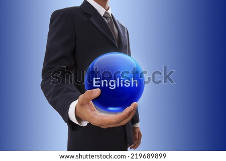 Businessman hand holding blue crystal ball with english word.  - stock photo
