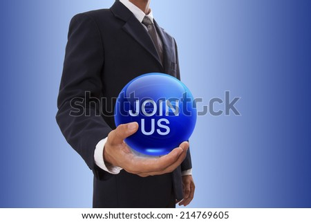 Businessman hand holding blue crystal ball with join us word.  - stock photo