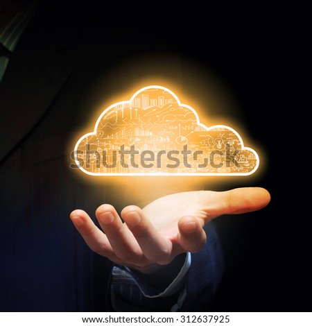 Businessman hand holding cloud computing concept in palm - stock photo