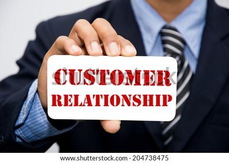 Businessman hand holding customer relationship concept  - stock photo