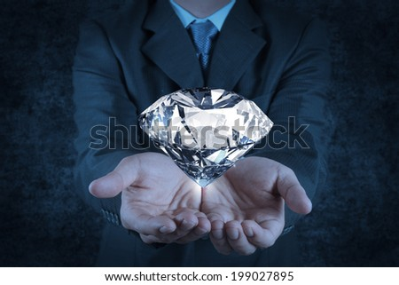 businessman hand holding 3d diamond as concept - stock photo