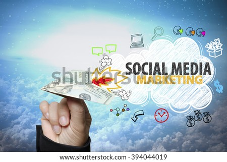 businessman hand holding dollar plane with SOCIAL MEDIA MARKETING text ,business idea , business concept  - stock photo