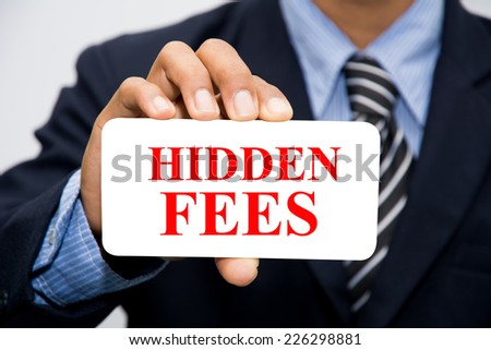 Businessman hand holding HIDDEN FEES concept  - stock photo