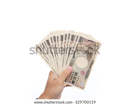 Businessman hand holding Japanese Yen