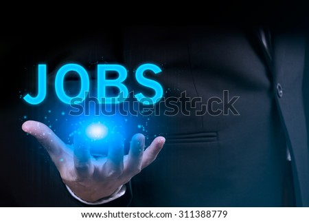 Businessman hand holding JOBS word - stock photo
