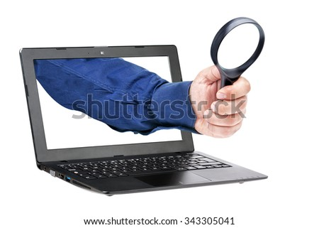 Businessman hand holding magnifying glass coming out from laptop display isolated