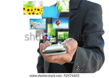 businessman hand holding mobile phone and streaming images virtual buttons
