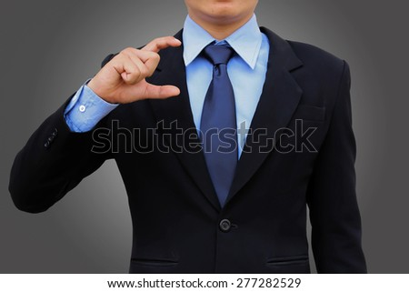 Businessman hand holding on dark background. - stock photo