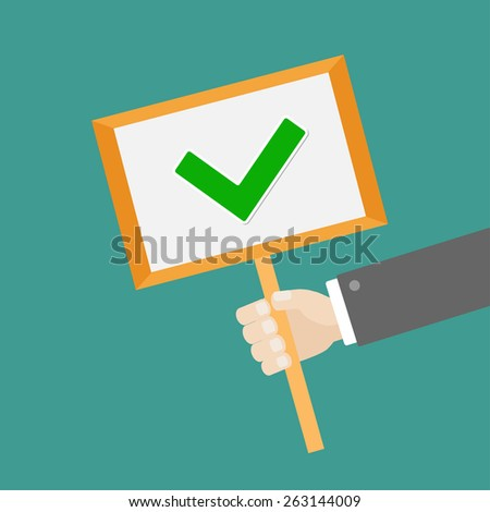 Businessman hand holding paper blank sign plate with green tick check mark Flat design  - stock photo