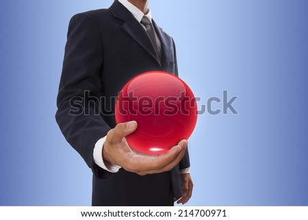 Businessman hand holding red crystal ball. - stock photo