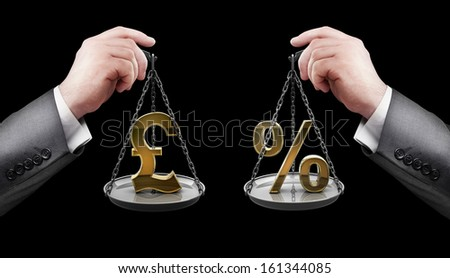 businessman hand holding Scale with procent symbols and symbols of currencies pound  - stock photo