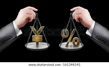 businessman hand holding Scale with procent symbols and symbols of currencies Yen  - stock photo